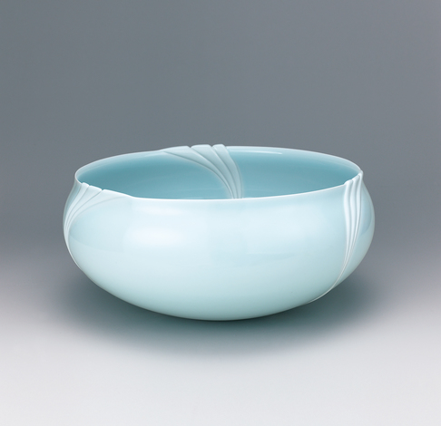 image Bowl with raised clay decoration.