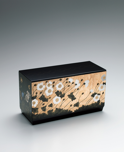 image Box with Japanese anemone design in makie on plain wood surface.