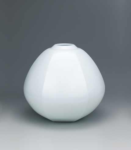 image Faceted white porcelain jar.