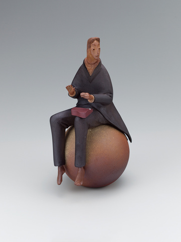 "image ""Musician"". Ceramic sculpture with polychromy."