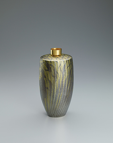 image Silver flower vessel with gold decoration.