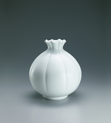 image White porcelain jar with lily-shaped mouth.