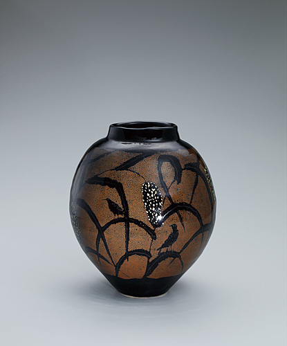 image Jar with iron glaze and millet design.