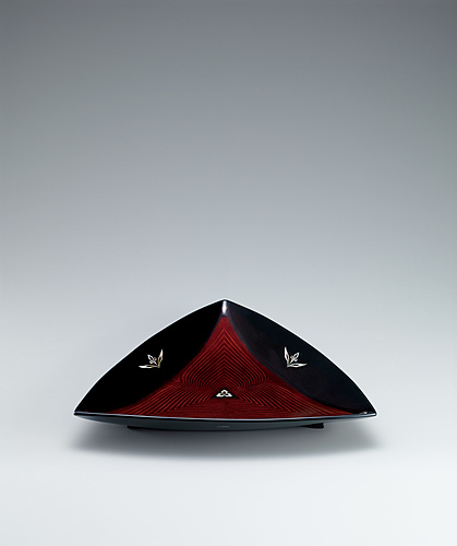 image Triangular food vessel with mother-of-pearl inlay.