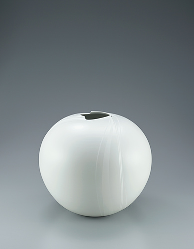 image White porcelain jar with silky white decoration.