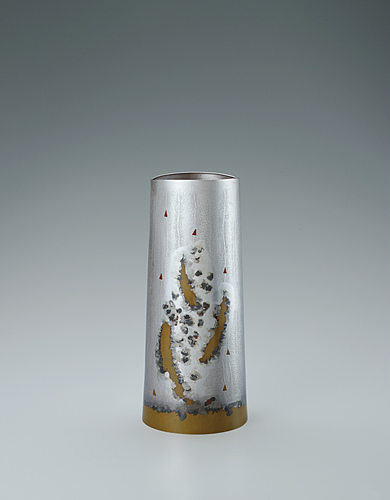 "image Flower vessel of silver and brass with stirred design. ""Beautiful sound of aspiration"""
